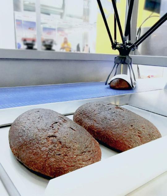Zrobotyzowana stacja pakowania chlebów do koszy - OCTA